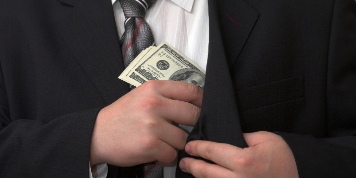 Businessman hides five banknotes of american dollars