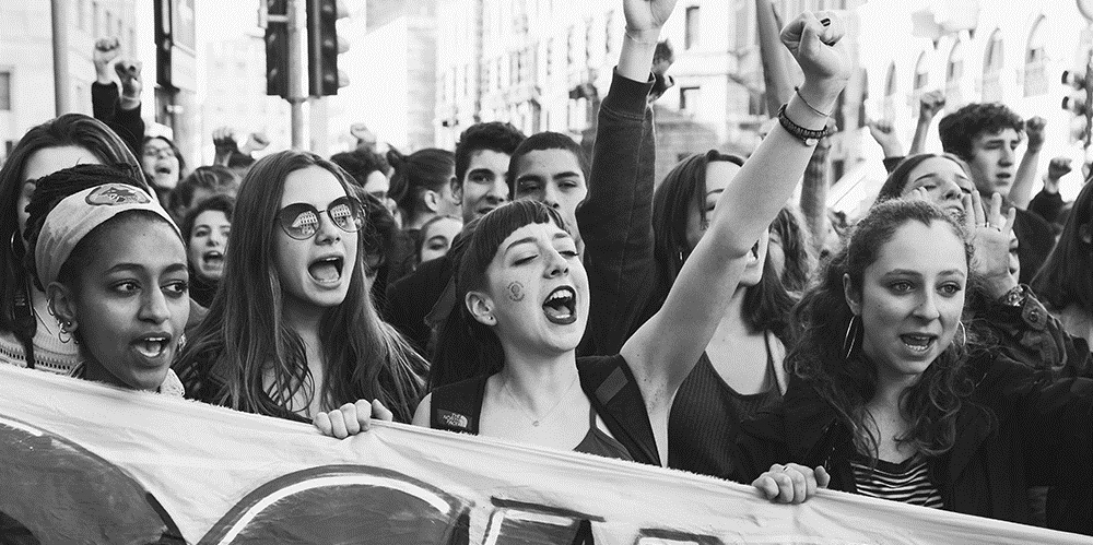 MILAN ITALY - MARCH 8: Secondary school students take part in a march to celebrate the International Women's Day on MARCH 8 2017 in Milan.